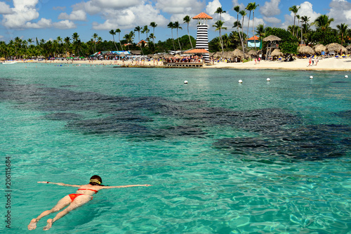 Relaxing tourist swimming on the Dominicus beach on Dominican Republic. Coast of the Del Este national park close the capital city Santo Domingo