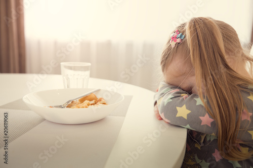 Fotografie, Obraz  Girl refuses to eat. Child meal difficultes theme.
