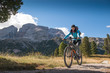 pretty young woman on bicycle in italien dolomites,  south tyrol, platzwiese
