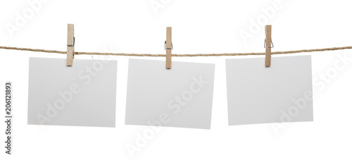 Cuadros en Lienzo White blank cards with copy space on rope isolated on white background