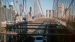 Cars and people pass by through different levels of Brooklyn Bridge. Amazing perspective view of New York cityscape 4K.