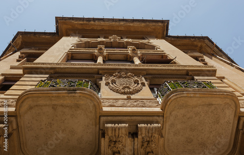 Fotobehang Oude gebouw Decorated Facade with Balcony of an ancient Building of the Belle Epoque in Quartiere Coppede, Rome, Shot from below