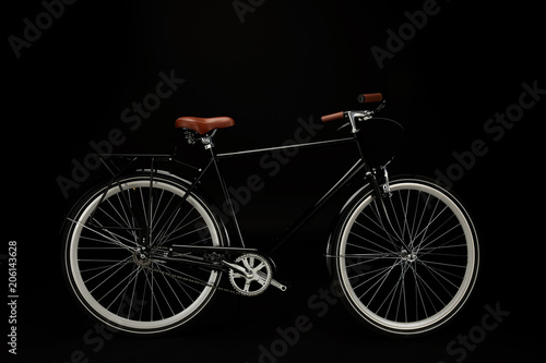 side view of classic vintage bicycle isolated on black