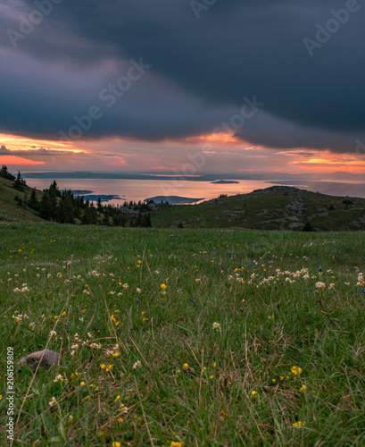Landscape view of Croatian islands in the Adriatic sea from the Velebit mountain during a beautiful colorful sunset, national park Velebit in Croatia