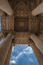 """Odd Perspective Of Columns At The Pantheon Entrance In Neoclassical Style And Cloudy Sky In Paris. Known As The """"City Of Light"""", Is One Of The Most Impressive World's Cultural Center. Northern France."""