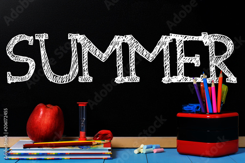 Valokuva  Text Summer on black chalkboard with school accessories