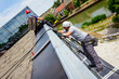 Industrial climbers are applying silicone on joints between windows