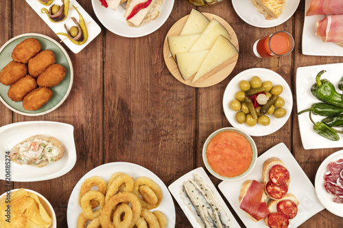 The food of Spain. Overhead photo of many different Spanish tapas with a place for text