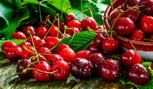 Cherries On Wooden Table With ...