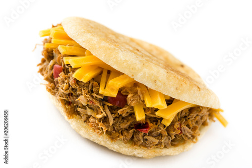 Arepa with shredded beef and cheese isolated on white background. Venezuelan typical food