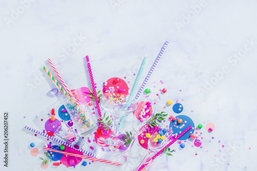 Cocktail glasses variety from above with straws, candies and confetti Poster