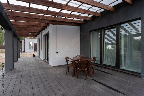 Side view of an open veranda in front of a modern forest cottage Canvas