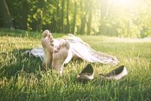 Girls Legs Lying In Grass Bare...