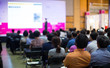 Audience at Conference Listening to Speaker Presenter Giving Talk at Meeting. Business Meeting in Conference Hall