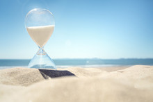Hourglass Time On A Beach In The Sand