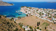 Aerial drone bird's eye view photo of port and traditional fishing village of Perdika in island of Aigina, Saronic Gulf, Greece