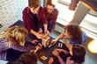 canvas print picture - Top view friends play indoor board games.