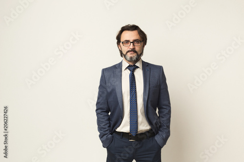 Obraz Handsome confident bearded businessman portrait - fototapety do salonu