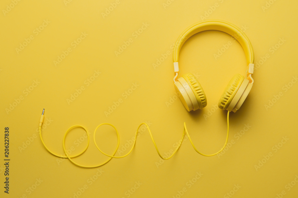 Fototapety, obrazy: Yellow headphones on yellow background. Music concept.