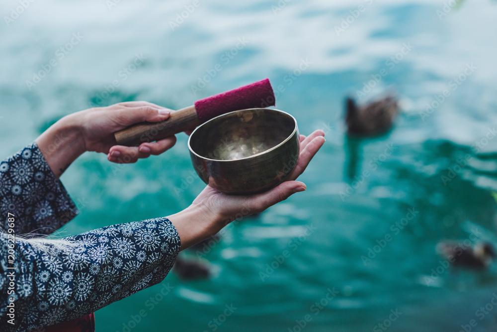 Fototapeta Young woman with Tibetan bowl