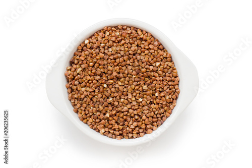 Valokuva  buckwheat groats in a white bowl on a white background