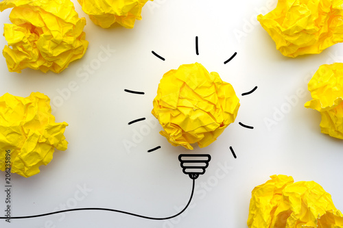 Fototapeta Creative idea, Inspiration, New idea and Innovation concept with Crumpled Paper light bulb on white background. obraz na płótnie