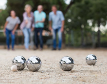 Males And Females Playing Petanque