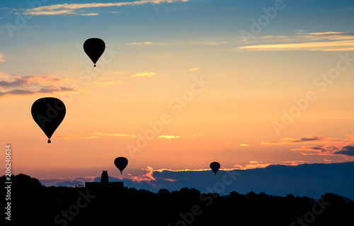 Hot air balloons on sunset. Beautiful nature background.