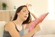 Leinwanddruck Bild - Woman suffering a heat wave at home