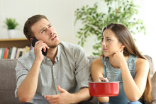 Couple Callling To Insurance F...