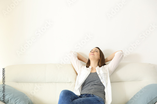 Valokuva  Woman relaxing on a couch with copy space above