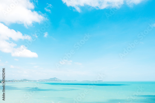 Keuken foto achterwand Turkoois Beautiful white clouds on blue sky over calm sea background.