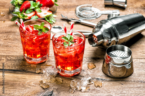 Fotografie, Obraz  Cocktail making bar tools Red drink with ice