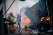 Firefighters on fire. Fireman extinguishes the fire with water. External market is on fire.