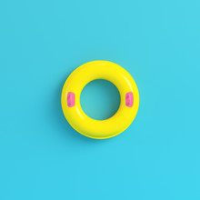 Yellow Inflatable Ring On Bright Blue Background In Pastel Colors