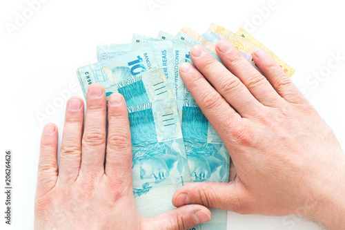 Fotobehang Palm boom Brazilian money, reais, high denominations held in the palm of your hand