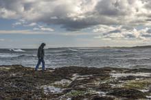 Lonely Man Walking On Rocky Sh...