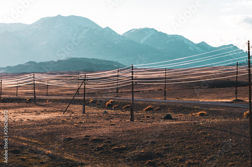 Papiers peints Marron chocolat beautiful landscape of electric wires gleaming in the sun on the hills background