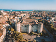 Aerial View Of The Civic Museum At The Castello Ursino In Catania, Sicily With The Sea On The Horizon.