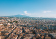 Beautiful aerial view of the Catania city on Sicily from above with Etna volcano visible on the horizon.