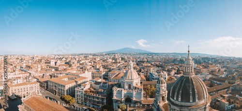 Wall Murals Air photo Aerial view of the Cathedral of Sant'Agata in the middle of Catania with Etna volcano on the background