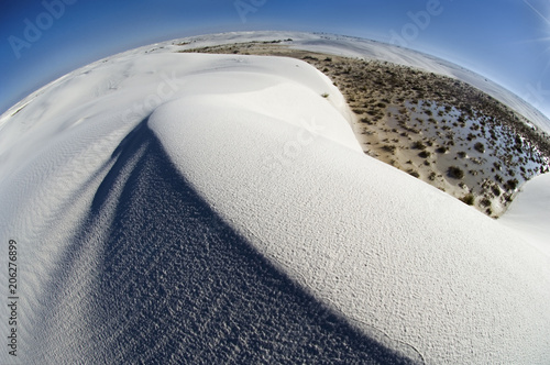 Valokuva  Swirling ridges and textured patterns of sand accentuate a more global perspective of White Sands National Monument