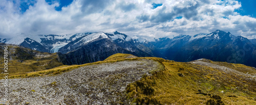 Foto op Aluminium Bergen snowy mountains and white clouds