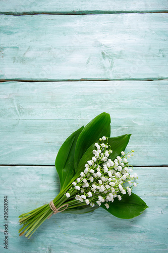 Staande foto Lelietje van dalen lilly of the valley flowers on wooden surface