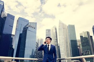 Fototapeta Asian businessman in a city