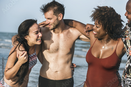 Fotobehang Wintersporten Friends having fun on the beach