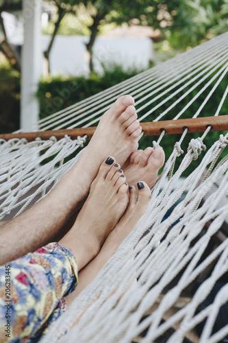 Fotobehang Wintersporten Couple resting together in a hammock
