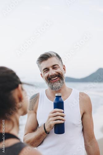 Fotobehang Wintersporten Man drinking water to rehydrate