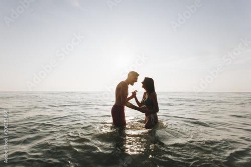 Fotobehang Wintersporten Couple playing in the water