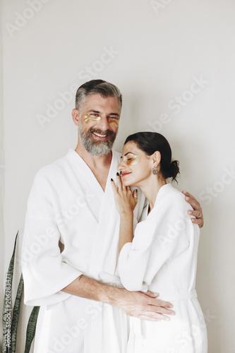 Fotobehang Wintersporten Couple relaxing with golden eye mask treatment
